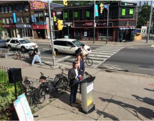 Councillor Joe Cressy announces Tour de Bloor (Bike and Buy) Passport.